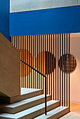 Patterns of geometric shapes and colours in hallway and stairwell