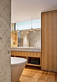 Designer bathroom in Carrara marble and oak wood