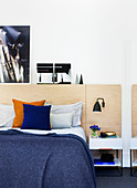 Double bed with plywood headboard in the bedroom fimmer