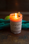 Cinnamon and apple scented candle in jar