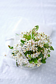 Bride's posy of white flowers and tulle