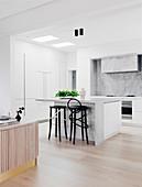 Bright, open kitchen with breakfast bar