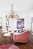 Elegant upholstered sofa and coffee table under a chandelier