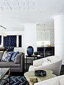 Upholstered furniture in an open living room with white supports