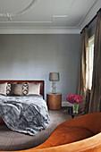 Elegant bedroom in gray and brown
