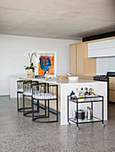 Semicircular chairs at kitchen island in modern architect-designed house