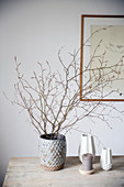 Twigs in a vase on a wooden table