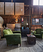 Green upholstered furniture and vintage accessories in lounge with wooden paneling