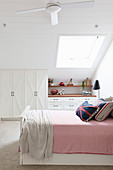 Girls room with bed and built-in closet in the attic