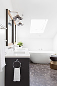 Double vanity and free-standing bathtub in the attic bathroom