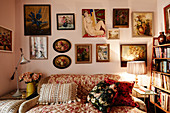 Gallery of pictures above sofa in granny-chic living room