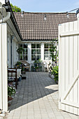 Open gate leading into courtyard of Swedish house
