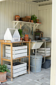 Potting table and garden sink in roofed area