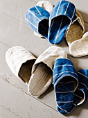 Several pairs of slippers hand-sewn from old fabric