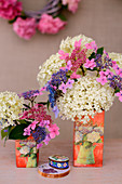 Various hydrangeas in vases decorated using napkin decoupage