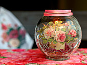 Romantic candle lantern decorated with rose motif in napkin decoupage