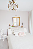 Vintage-style bedroom in white and pale grey