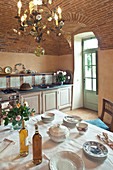 Set table in Mediterranean kitchen with vaulted ceiling