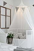 Cot with illuminated canopy and bunting