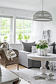White pedestal table in grey-and-white living room