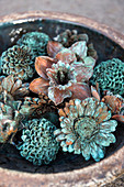 Flower arrangement in shades of copper and verdigris