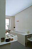 Bathtub and designer shelf in bathroom