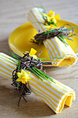 Yellow and white striped napkins with Easter wreaths and yellow plate