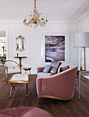 Elegant sofa, tray table with golden edge and Gustavian chair in the living room