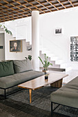 Lounge with gray sofas and designer coffee table