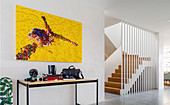 Modern art above console table, staircase in background