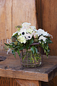 Bouquet of anemones, carnations, ivy leaves and ivy berries