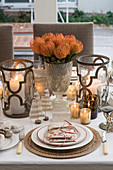Festively decorated Christmas table set in white with metallic accents