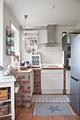 Brick base units in corner of Nordic-style kitchen