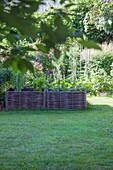 Raised wicker bed in garden