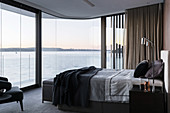 Double bed in the bedroom with panoramic sea views