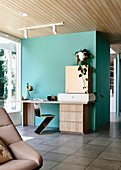 Zig-Zag chair and desk on turquoise room divider in open living room