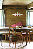 Hand-made paper lampshade over rustic dining table
