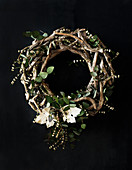 Wreath of woven twigs and eucalyptus leaves