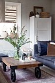 Coffee table on wheels in living room in muted shades