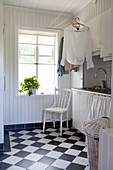 Rustic utility room with chequered floor