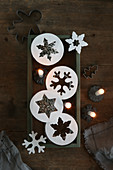Star and snowflake pendants and lit candles