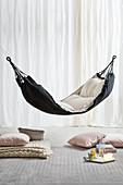 Cushions and tray below cushioned hammock