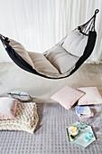 Cushion and tray below cushioned hammock