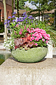 Lushly planted, green hypertufa planter