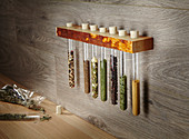 Storage idea for spices in test tubes in wall-mounted rack