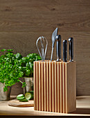 Wooden organiser and knife block in kitchen