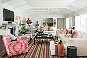 Striped rug in white living room with colourful accessories