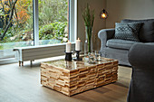 DIY coffee table made from wooden panels and glass top