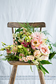 Pink bridal bouquet on vintage chair