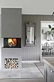 Fire in modern fireplace in grey interior